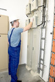 Electrician holding the power switch — Foto Stock