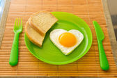 Fried egg in the shape of heart — Stock Photo