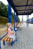 Little girl waiting for the train — Stock Photo