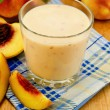 Milk cocktail with peach on the napkin — Stock Photo #12898082
