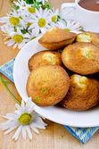 Biscuits with tea and camomiles — Stock Photo