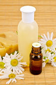 Oil and soap with chamomile — Stock Photo
