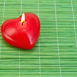 Stock Photo: Heart of candles on bamboo