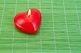 Heart of candles on bamboo — Foto Stock