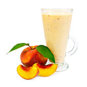 Milkshake with peaches — Stock Photo