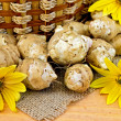 Stock Photo: Jerusalem artichokes with yellow flowers and basket