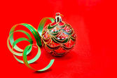 Christmas red ball with green ribbon — Stock Photo
