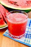 Juice watermelon on a napkin and a board — Stockfoto