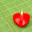 Heart of red candles on bamboo — 图库照片