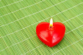 Heart of red candles on bamboo — Foto de Stock
