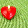 Heart of candles on a green bamboo — Stock Photo