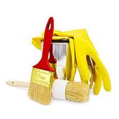 Borstels met gele handschoenen en een pot — Stockfoto
