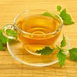 Royalty-Free Stock Photo: Herbal tea with nettles on a bamboo mat