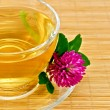 Herbal tea with clover on a bamboo mat — Stock Photo