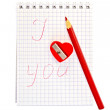Sharpener in the shape of heart with notepad — Stock Photo