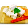 Feta cheese pieces with colored peppers — Stock Photo