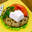 Royalty-Free Stock Photo: Feta piece with tomato on crispbread