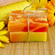 Soap homemade orange and yellow with marigold — Stock Photo