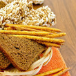 Rye bread and crispbreads in a wicker plate — Stock Photo