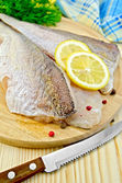 Fillets codfish on a board with a knife — Photo