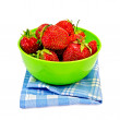 Strawberries in a green bowl with a napkin - Stock Photo