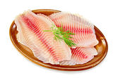 Fillets tilapia in a pottery — Stock Photo