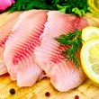 Stock Photo: Fillets tilapiwith oil and lemon