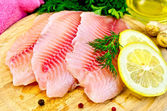 Fillets tilapia with oil and lemon — Stock Photo