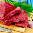 Meat beef on a wooden board with a knife — Stock Photo