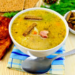 Soup pea with bacon and crispbreads — Stock Photo