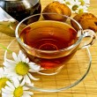 Herbal tea with daisies and kettle — Stock Photo