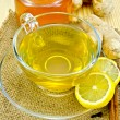 Tea ginger on a napkin of burlap with honey — Stock Photo #23910055