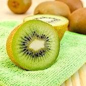 Kiwi on a green napkin — Stock Photo