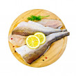 Fillet of codfish on a round board with dill — Stock Photo