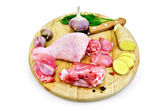 Chicken leg cut on a round board — Stock Photo
