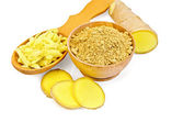Ginger powder and grated in a wooden dishes — Stock Photo