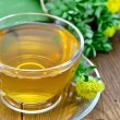 Herbal tea with Rhodiola Rosea on a wooden board — Stock Photo