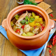 Stock Photo: Roast chicken in clay pot with hot pepper