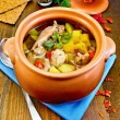 Stockfoto: Roast chicken in clay pot on board