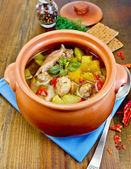 Roast chicken in a clay pot with hot pepper — Stock Photo