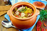 Roast chicken in a clay pot — Stock Photo
