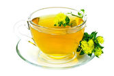 Kruiden thee met bloemen rhodiola rosea op schotel — Stockfoto
