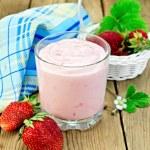 Milkshake with strawberries in a white basket — Stock Photo