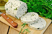 Cheese homemade with herbs cut on a board — Stock Photo