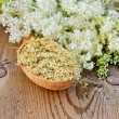 Herbal tea from meadowsweet dry on a spoon — Stock Photo