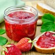 Stock Photo: Jam strawberry with bread on board