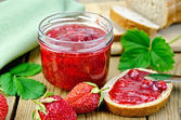 Jam strawberry with bread on the board — Stock Photo