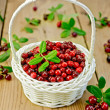 Lingonberries in a white wicker basket — Stock Photo