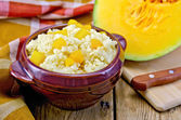 Porridge millet with pumpkin and knife — Stock Photo