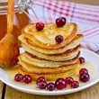 Flapjacks with cranberry and spoon on board — Stock Photo